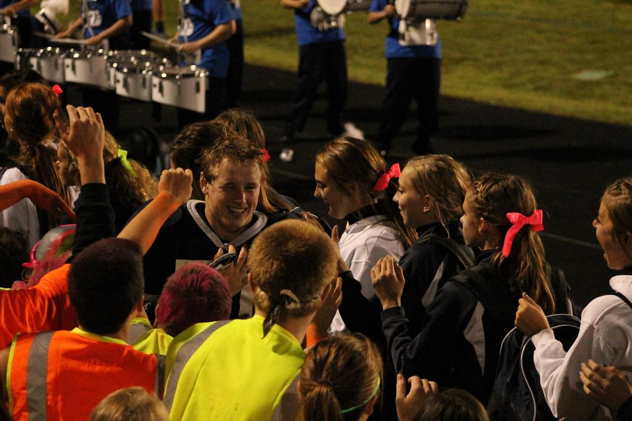 Kersten smiles as he celebrates a win with the supportive C-G community he loves.