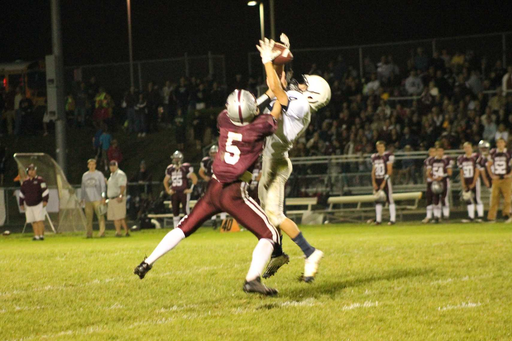 Hanselmann fights with a receiver to bring down the ball.