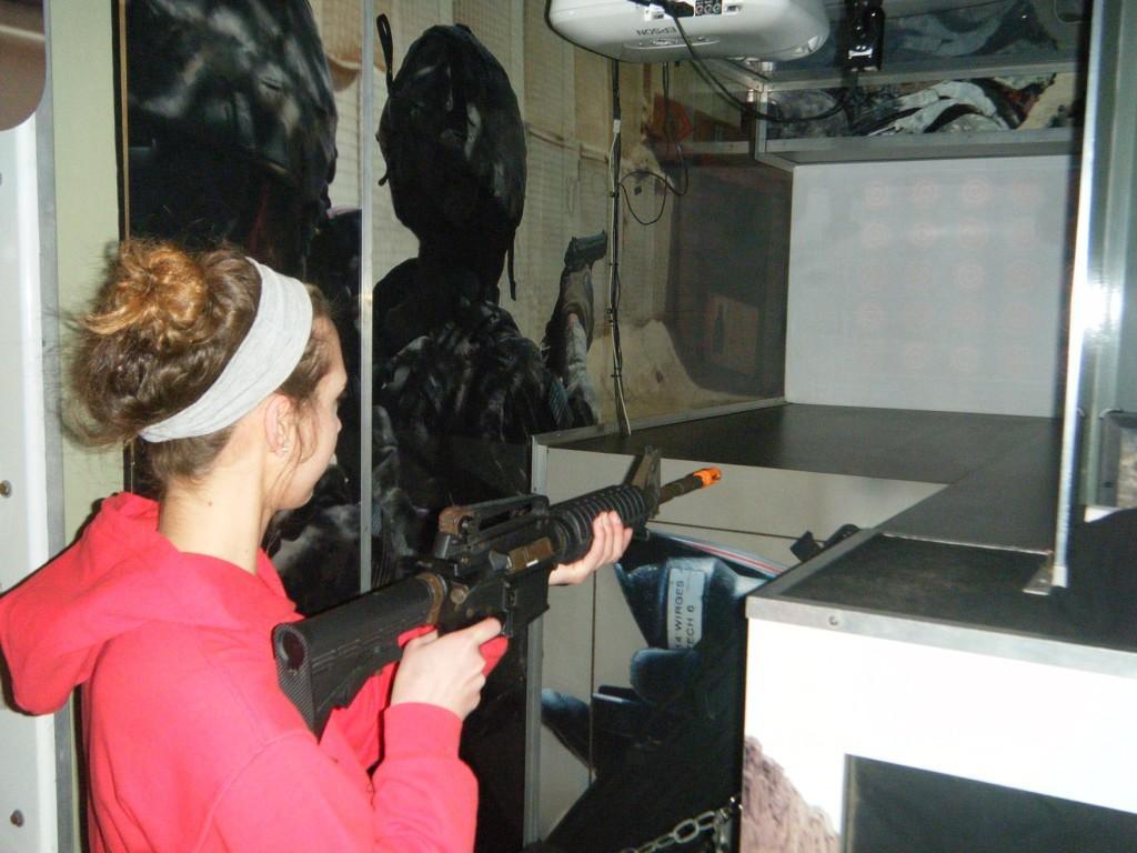 Senior Amy Jereb takes aim in a U.S. Army shooting simulation.