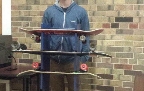 Senior Galanos creates skateboard rack for CG students